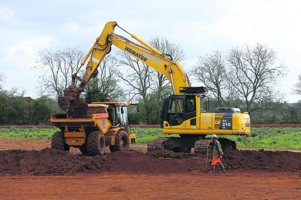 This Is Wiltshire: Diggers move in at Coate