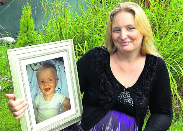 This Is Wiltshire: Kelly Pritchard with a portrait  of her son, Alfie-Ray