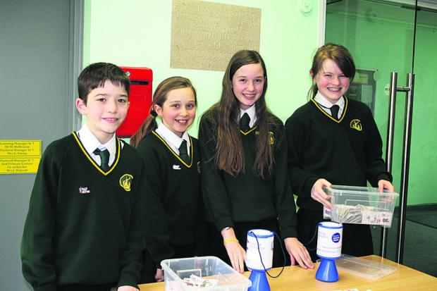 This Is Wiltshire: Fundraising Year 7s, from left, Ewan Radford, Eleanor Gould, Naomi Lambert and Aoife Locke