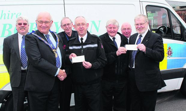 This Is Wiltshire: Phillip Bullock, assistant provincial grand master of Wiltshire and Arthur Bierschenk,        worshipful master of the Lodge of Loyalty, Marlborough, presenting a cheque to the trust