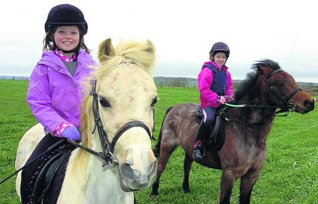 This Is Wiltshire: Riders Elouise Webb with Devon and Abigale Wood with Woody