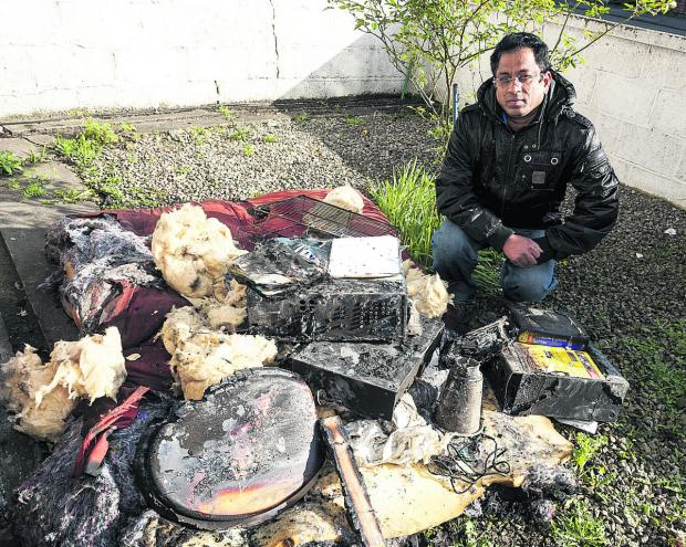This Is Wiltshire: Ubaldo Carvalho with some of his  possessions damaged by a fire that spread to the house he shares with his brother and family in County Ro