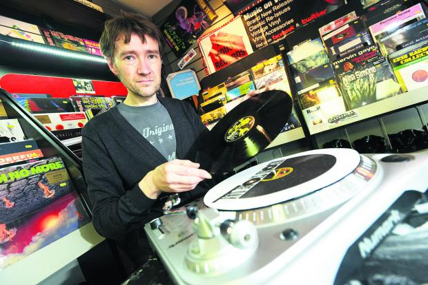 This Is Wiltshire: Paul Holmes, of Red House Records, with some of the records