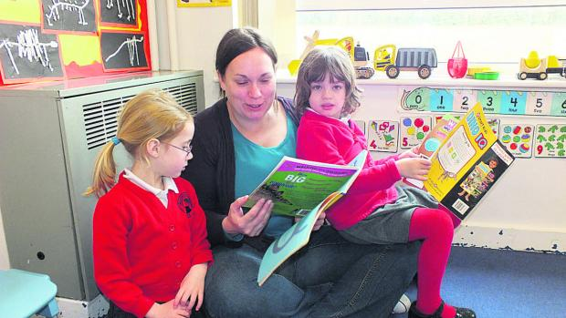 This Is Wiltshire: Melanie Gordon enjoying a book with two members of Thistle class on Mother's Monday