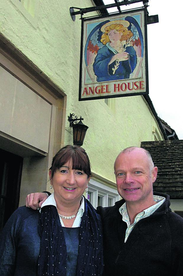This Is Wiltshire: Former England cricketer Paul Jarvis and wife Caroline outside The Angel in Sherston, which they have now opened as a tearoom