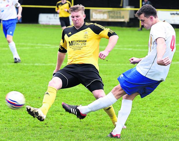 This Is Wiltshire: Melksham's Ben Thomson flies into a challenge during Saturday's goalless draw against Willand Rovers Photo: Diane Vose (DV1235-005)