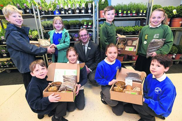 This Is Wiltshire: Marlborough area children from Ogbourne, Burbage, Pewsey and Ramsbury schools with Waitrose's department manager, Charles Bentley, and their seed growing kits for summer produce