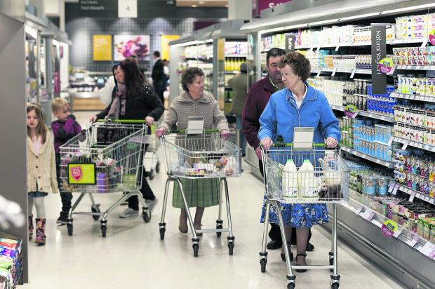 This Is Wiltshire: Customers shopping in the new Waitrose in Mill Lane, Wichelstowe