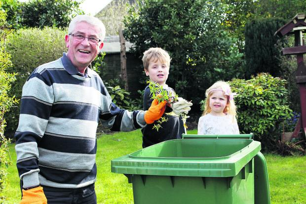 This Is Wiltshire: Former railway worker Phil Harman, from central Swindon, with his grandchildren Max, six and Zoe, three with his green waste bin The first collection round of the new optional, paid-for green waste service takes place this week