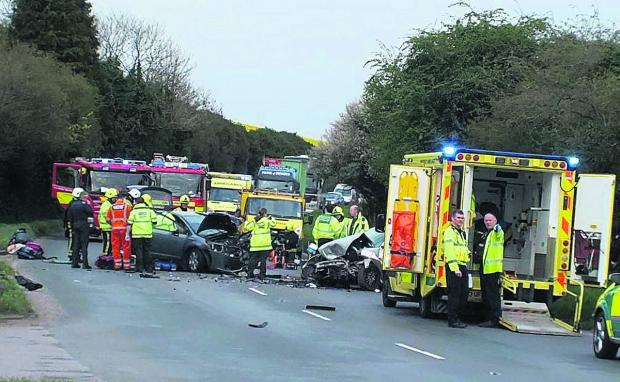 This Is Wiltshire: Rescue service personnel at the scene of yesterday's crash