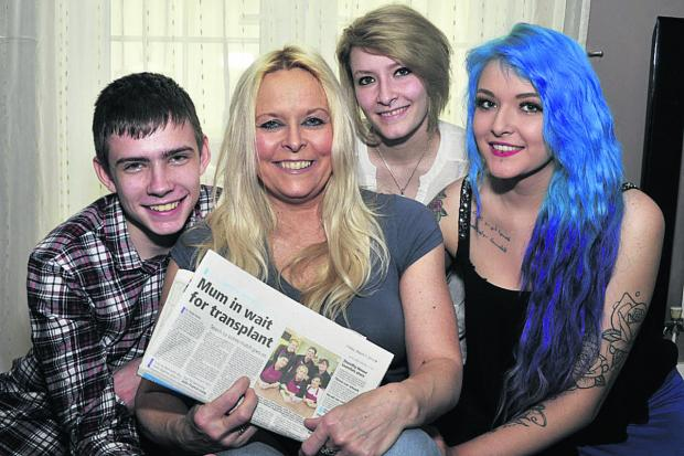 This Is Wiltshire: Julie Francis-Lang of Westbury who is waiting for a kidney transplant, pictured  with her children Gary, 15, Courtney, 17, and Mica, 19