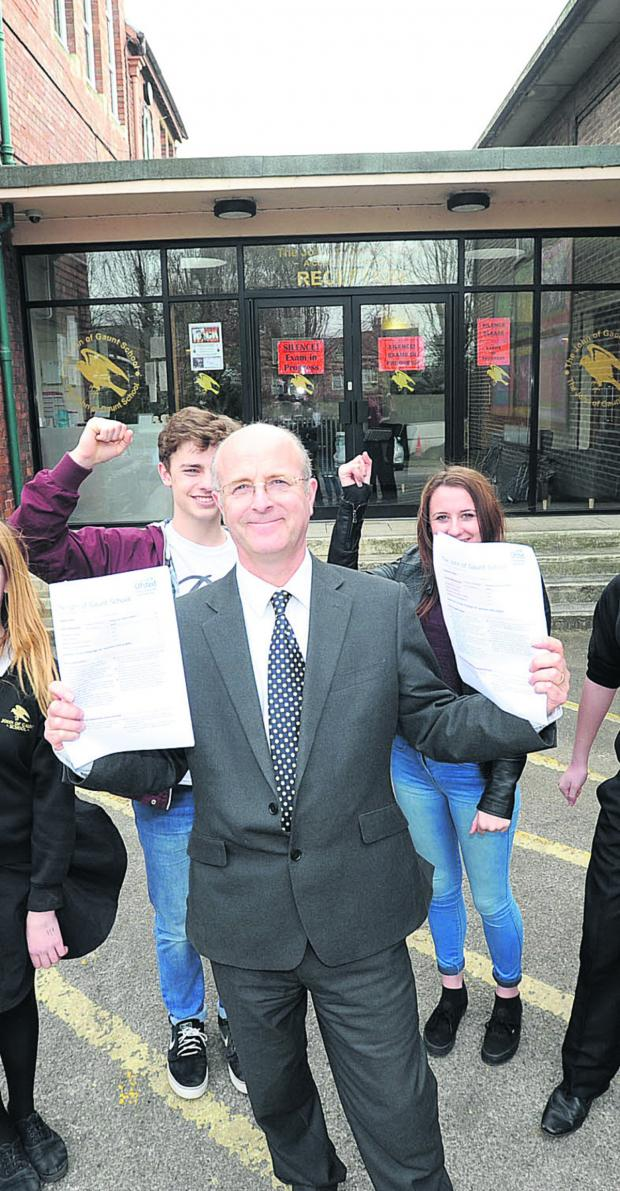 This Is Wiltshire: John of Gaunt headteacher Andy Packer celebrates the good Ofsted report with sixth formers Max and Olivia
