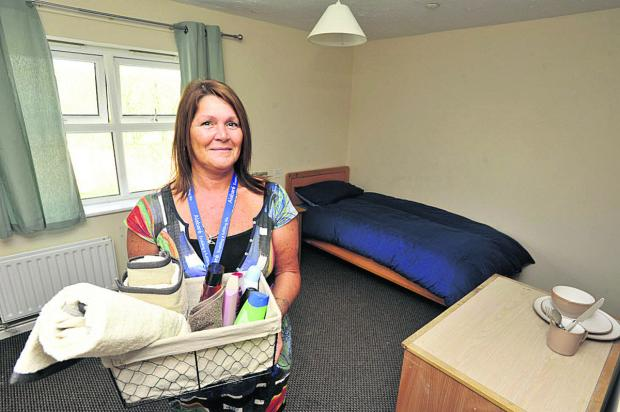 This Is Wiltshire: Andrea Wood, manager of the Alabaré hostel in Hilperton, in one of the charity's rooms for vulnerable youn