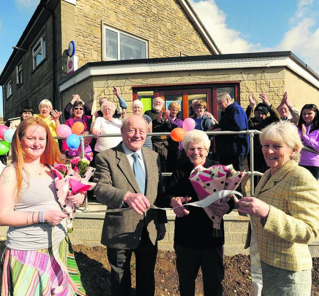This Is Wiltshire: Shop assistant Lindsay Ackland Sutton, left, postmaster Ray Parson, Pearl Rumbold and shop keeper Rita Parsons salute the new look