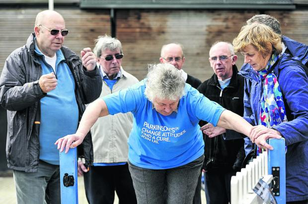 This Is Wiltshire: Members of the Swindon branch of Parkinson's UK in Wharf Green with mayor Nick Martin