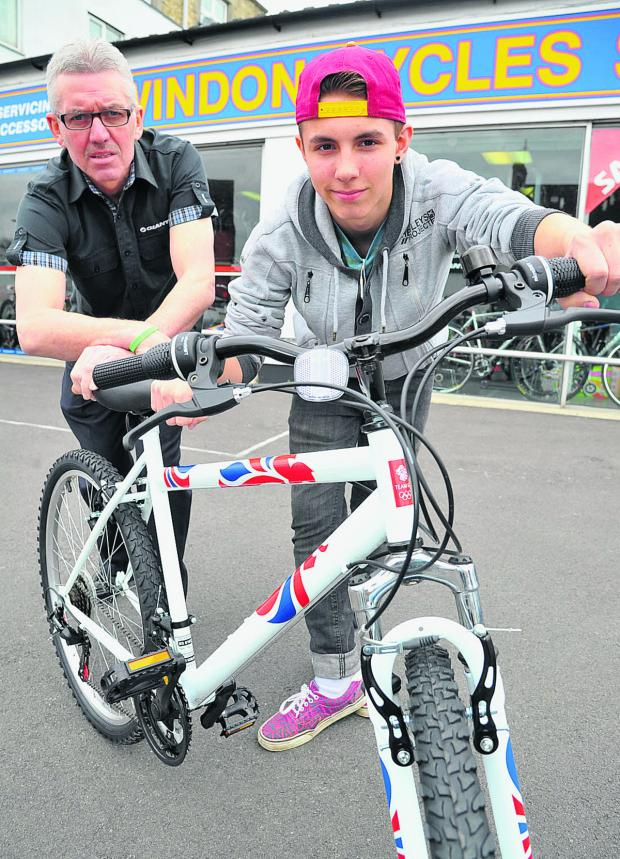This Is Wiltshire: Swindon Cycles have donated a bicycle to Adver delivery boy Sam Robinson, who had his bike stolen. Sam is pictured with shop manager Graham Terrett