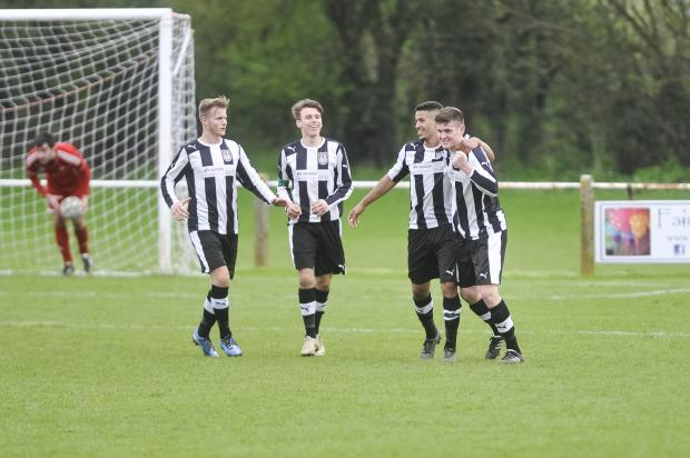 This Is Wiltshire: Malmesbury Victoria players celebrate Chris Jackson's winner against Fairford Town