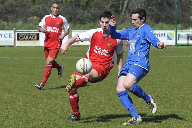 This Is Wiltshire: Nick Holton (left) scored Corsham Town's second goal against Calne Town last weekend