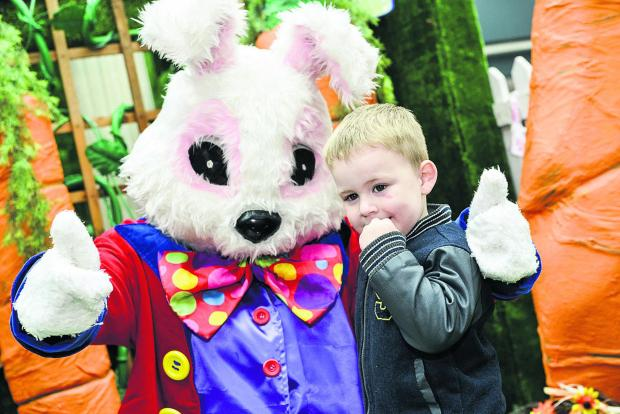 This Is Wiltshire: The Easter Bunny met three-year-old Codie Ockwell when he dropped in to the Brunel Centre
