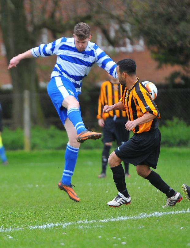 This Is Wiltshire: Action from the weekend clash between Blunsdon and Wroughton