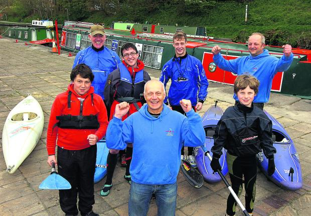 This Is Wiltshire: Canoe Club vice chairman Mark Bouch celebrates news of the windfall with canoe club members