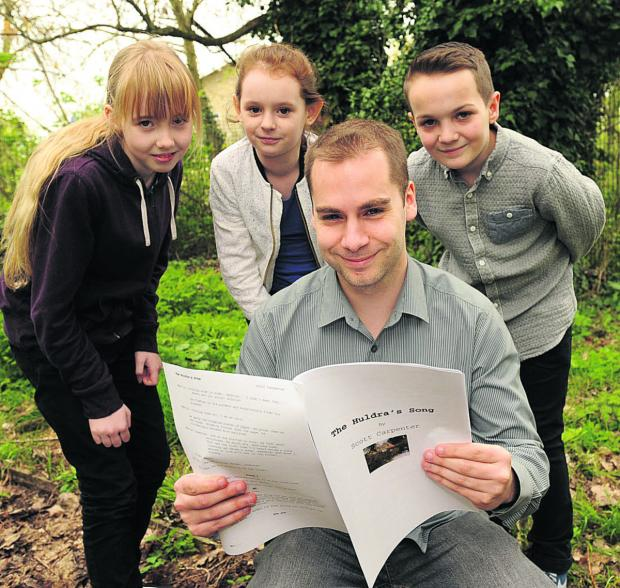 This Is Wiltshire: Teacher Scott Carpenter with young actors Eleanor, Rachael and Casey reading up on the script for The Huldra's Story