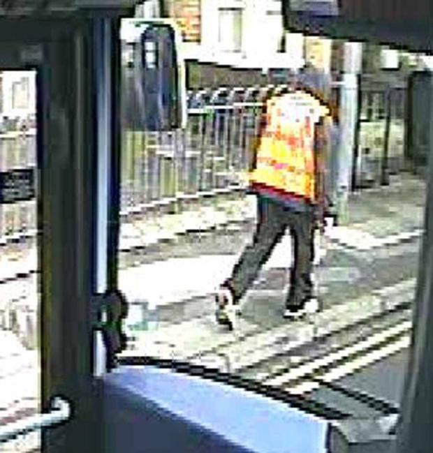 This Is Wiltshire: A CCTV still of the male suspect police wish to talk to following the theft of cash from a lorry