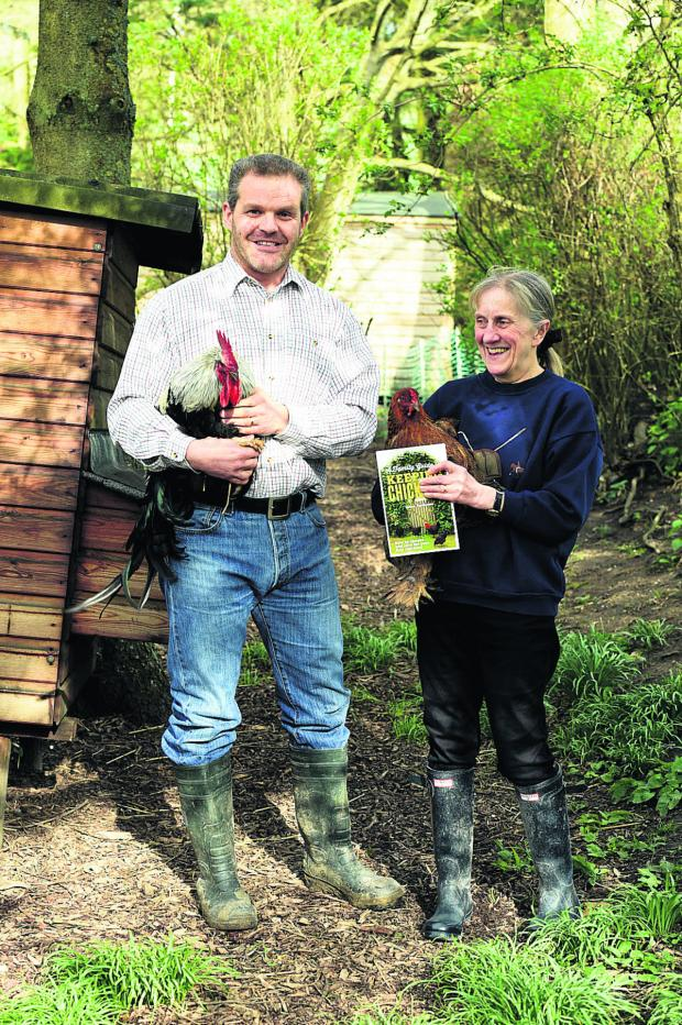 This Is Wiltshire: Martin and Anne Perdeaux with two of their chickens at home in Upavon           (DV1240) PICTURE BY DIANE VOSE
