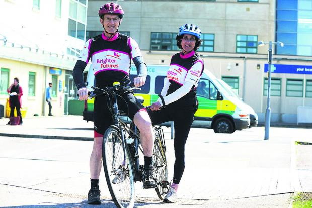 This Is Wiltshire: Doctors David and  Lyn Williamson, who  are doing a tandem ride for GWH's radiotherapy building