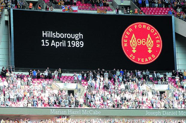 This Is Wiltshire: A tribute to those who lost their lives in the Hillsborough Disaster is seen on the giant screen at Anfield
