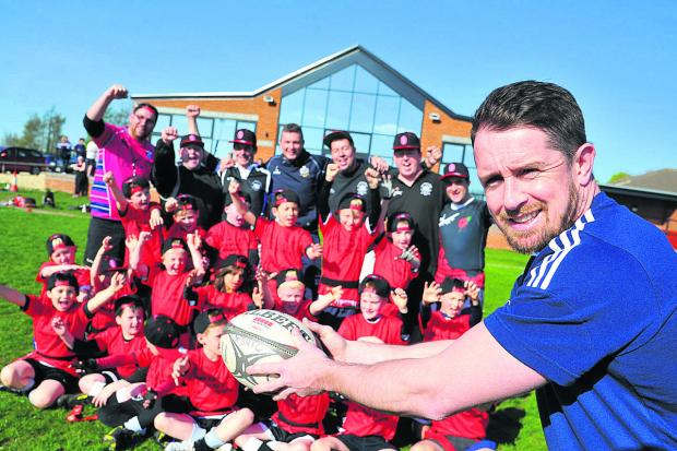 This Is Wiltshire: Former Wales and British Lions Star Shane Williams at Royal Wootton Bassett RFC with the under 8s team