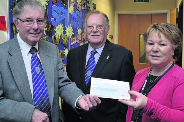 This Is Wiltshire: Manager Jayne Moverley, right, accepts the cheque at Melksham Police station from former lodge master John Fisher, left, and lodge secretary Colin Parfitt