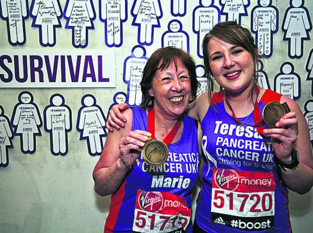 This Is Wiltshire: Mum and daughter Marie and Teresa Coupland with their race medal