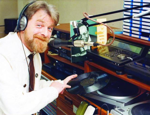 This Is Wiltshire: Surrounded by tapes, albums, a turn-table and a mic, Alan is in his element as he is pictured in 1989 at the BBC Wiltshire studios in Old Town. Today Alan can be heard every Saturday on Swindon 105.5