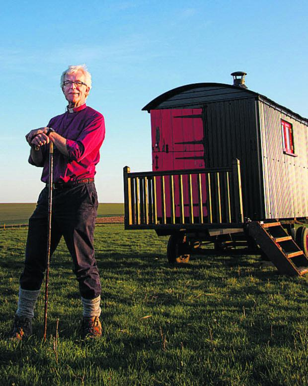 This Is Wiltshire: The Bishop of Ramsbury, the Rt Rev Ed Condry, at the shepherd's hut on the Wiltshire Downs he spent last night in