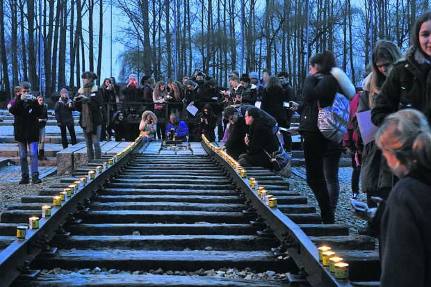 This Is Wiltshire: Memorial  candles are lit at Auschwitz II at the  end of the visit                     (49250) BY GLENN PHILLIPS