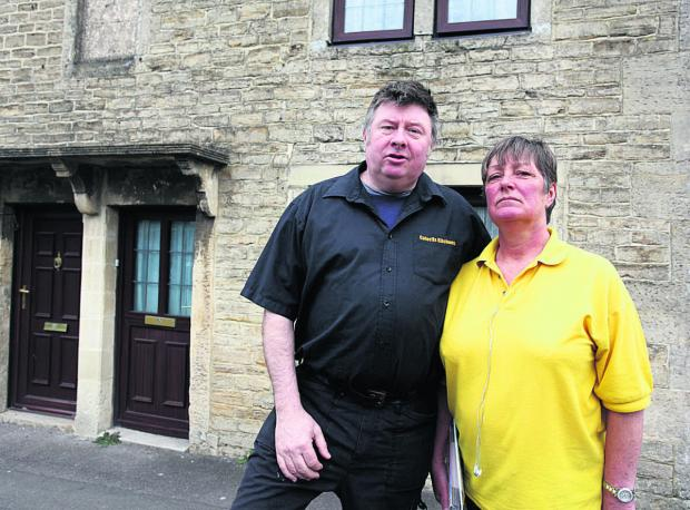 This Is Wiltshire: Rob and Frankie Jones' house shakes every time a bus or lorry drives past and the stone around the first floor window has moved an inch                                              (VS261) By VICKY SCIPIO