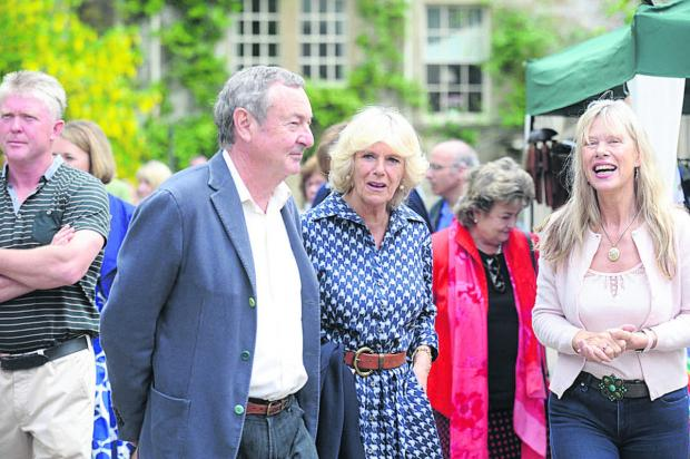 This Is Wiltshire: Pink Floyd drummer Nick Mason and wife Annette with the Duchess of Cornwall at last year's fundraising event at Middlewick House, Corsham