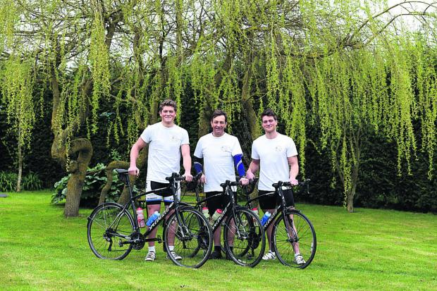 This Is Wiltshire: From left are Harry, Mike and Will Noel-Smith with their bicycles                    (DV1229) By Diane Vose