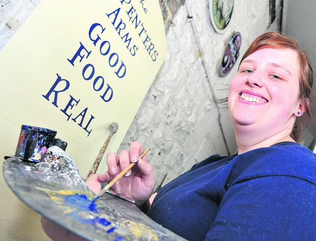 This Is Wiltshire: Competition winner Sarah Bromley, who is  Arkell's first female signwriter