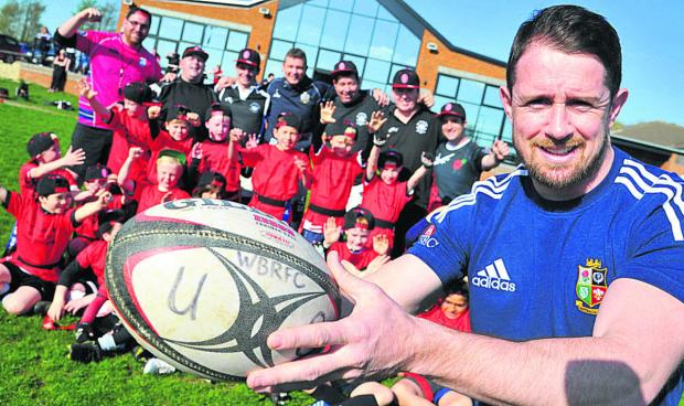 This Is Wiltshire: Former Wales and British Lions Star Shane Williams at the coaching session he gave Royal Wootton Bassett U8s at Ballards Ash on Tuesday