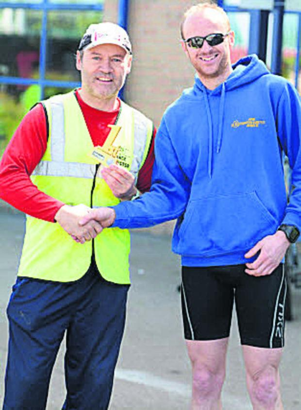 This Is Wiltshire: Duathlon winner Tim Purvey, right, with EventsLogic UK's Steve Fream