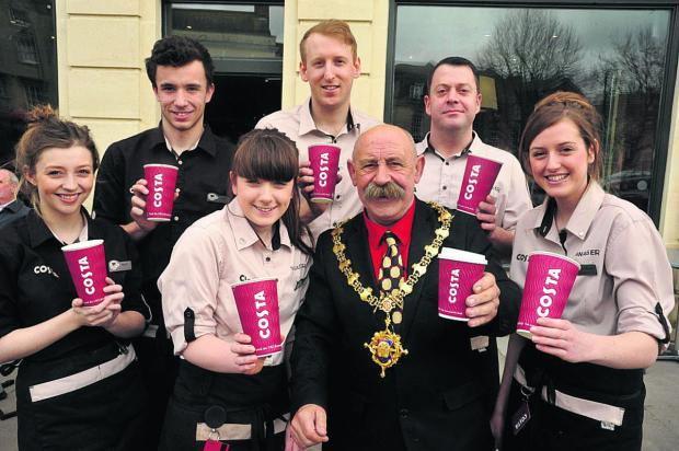 This Is Wiltshire: Market Place Costa staff with Devizes mayor Pete Smith and manager Matt Coulthard, right of the mayor  (VS289) By VICKY SCIPIO