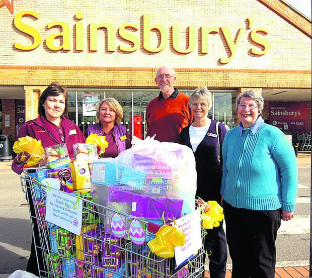 This Is Wiltshire: Pictured with the Easter eggs are Kathryn Seviour, Serena McKendrick, of Sainsbury's, Keith Coates, of the food bank, and Margaret Boyd, and Rose Hewer from the Salvation Army                                                                    (PM1179) b