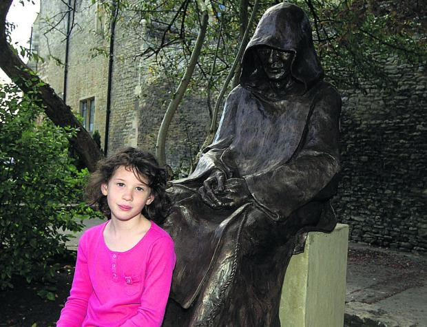 This Is Wiltshire: Malmesbury statue takes seat in town