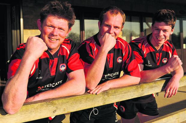 This Is Wiltshire: Dave George (left), the head coach of Bradford on Avon RFC, captain Oli Stacey and top points scorer Dan Bright  celebrate the club's Dorset & Wilts One North title win