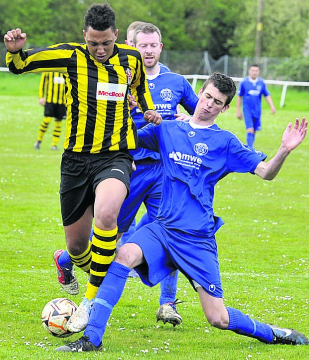 This Is Wiltshire: Trowbridge Town's Otis Young is challenged during last weekend's clash with FC Chippenham Youth