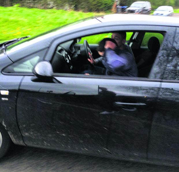 This Is Wiltshire: Police have issued this picture of the driver and passanger of a Vauxhall Corsa after a road rage incident