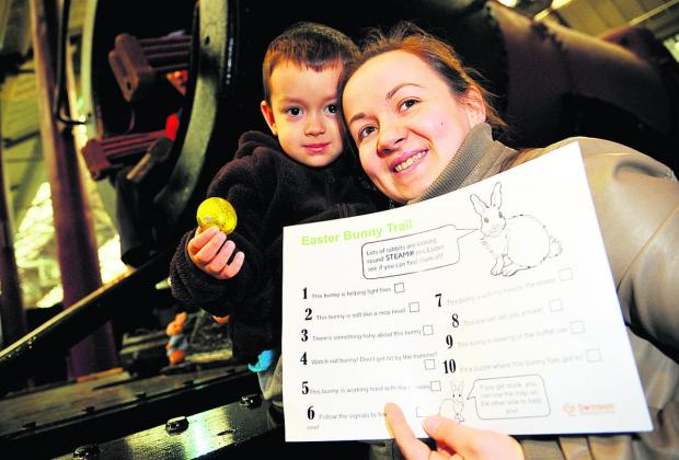 This Is Wiltshire: Kevin and Kasia Polewka Mendes, right, locate chocolate rewards at  the Easter bunny Trail at the Steam Museum