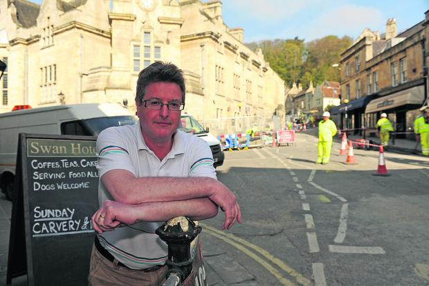 This Is Wiltshire: James Sullivan-Tailyour, owner of The Swan Hotel, monitors the jams and loss of business during the current roadworks
